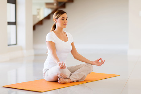 girl room: pretty young woman doing yoga exercise at home