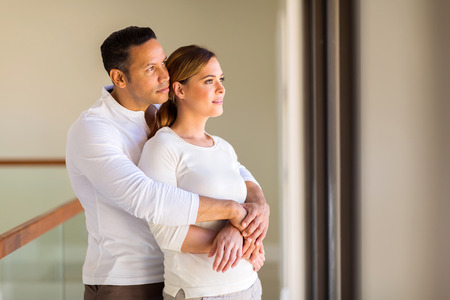 thoughtful mid age couple in their new home Stock Photo