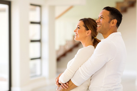 couple home: happy couple in new home Stock Photo