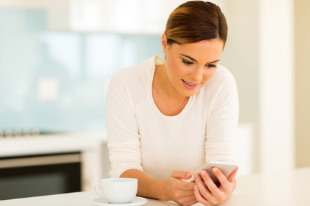 smartphone: pretty woman reading emails on smart phone