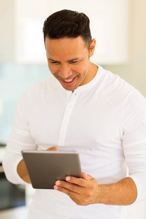 mid age: happy mid age man using tablet computer Stock Photo