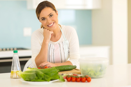 attractive woman in home kitchen photo