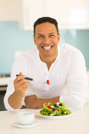 healthy eating: portrait of handsome man eating healthy food