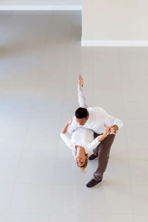 couple dancing: romantic couple dancing in their new house Stock Photo