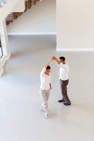 dancing house: overhead view of couple dancing at their new home