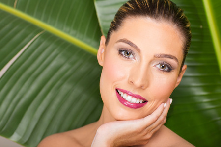 attractive gorgeous: gorgeous woman with clean makeup over green leaf