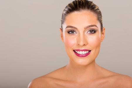 beauty shot: attractive young woman beauty shot closeup on plain background