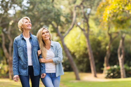 bird watching: happy mother and daughter in the forest bird watching