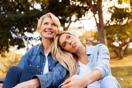 mid age: peaceful young daughter and mid age mother daydreaming Stock Photo