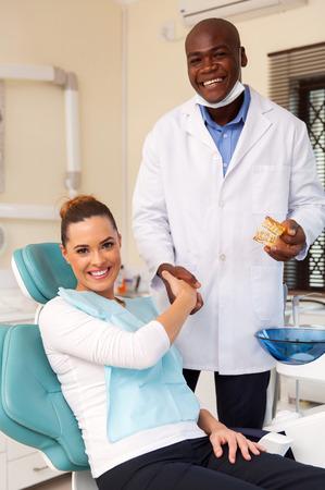 congratulate: portrait of happy dentist congratulate patient for a successful operation Stock Photo