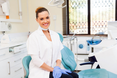 healthcare office: portrait of young female dentist in office