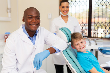 happy little boy with medical team in dental clinic Stock fotó