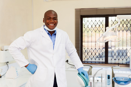 males: happy african american dentist in office Stock Photo