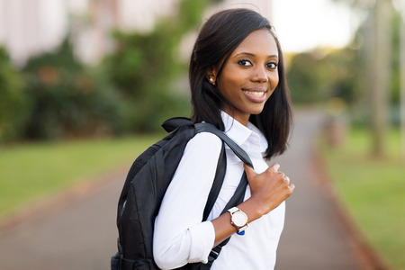 tertiary: beautiful female college student going to school