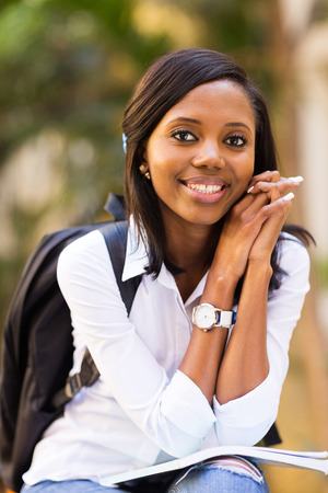 tertiary: happy african american college student outside campus