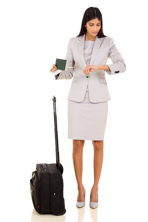 business traveller: professional indian business traveller checking time