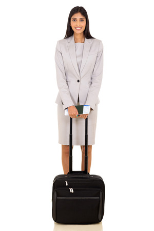 business traveller: smiling female indian business traveller with luggage bag on white background Stock Photo