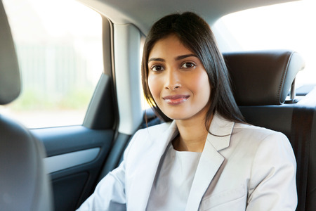 indian ethnicity: attractive young indian woman sitting inside a car Stock Photo