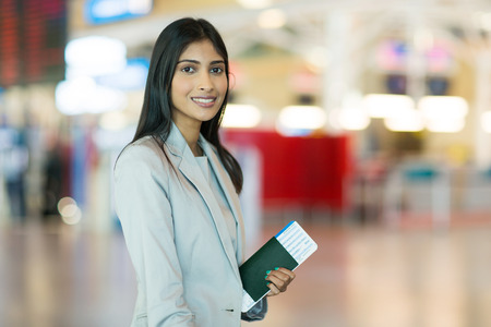 business traveller: portrait of pretty indian female business traveller at airport