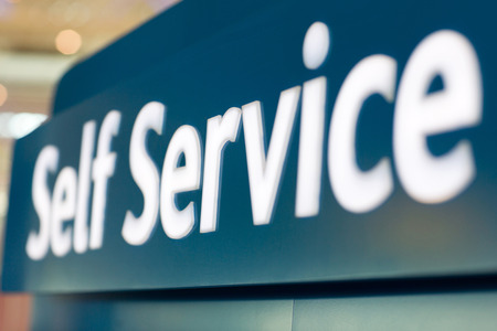 up service: close up of self service sign at airport Stock Photo