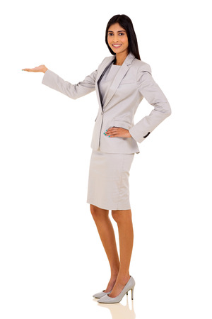 copyspace corporate: happy young indian businesswoman welcome gesture on white background