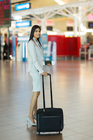 asian lady: beautiful young indian business woman going on business trip by air Stock Photo
