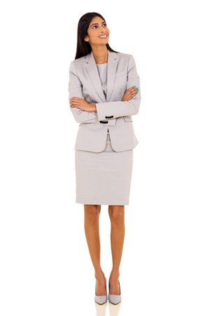 looking up: cheerful young indian businesswoman looking up Stock Photo