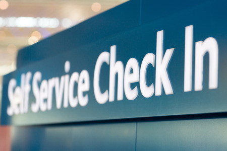 security check: self service check in sign at airport Stock Photo