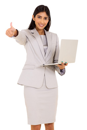 indian girl: cheerful indian businesswoman holding laptop and giving thumb up