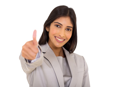 young worker: happy indian business executive giving thumb up