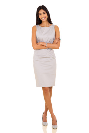 confident indian business woman with arms crossed on white background Foto de archivo