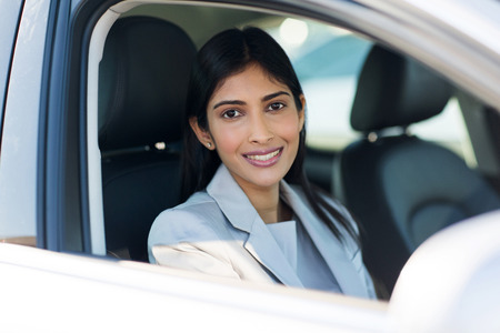 businesswoman suit: pretty indian woman inside a car Stock Photo