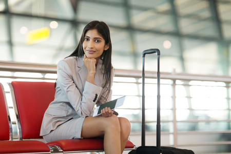 people travelling: pretty indian businesswoman waiting at airport for her flight Stock Photo