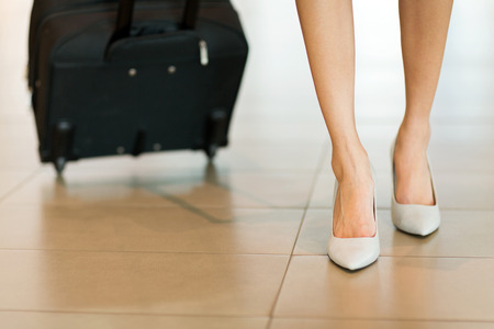 business traveller: business traveller walking at airport pulling luggage bag Stock Photo