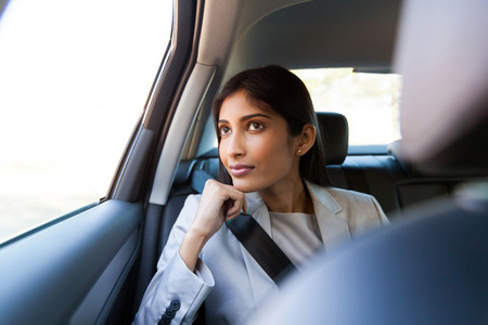 corporates: elegant young indian businesswoman sitting in car backseat Stock Photo