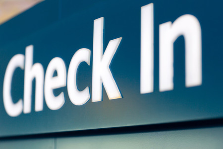 check in: close up of check in sign at airport