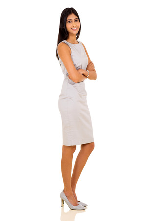 modern girl: side view of happy indian businesswoman standing on white background