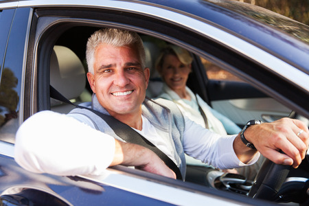 woman middle age: lovely middle aged couple driving a car Stock Photo