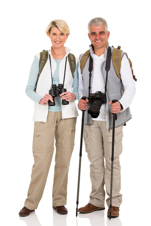happy couple white background: full length portrait of mid age couple standing on white Stock Photo