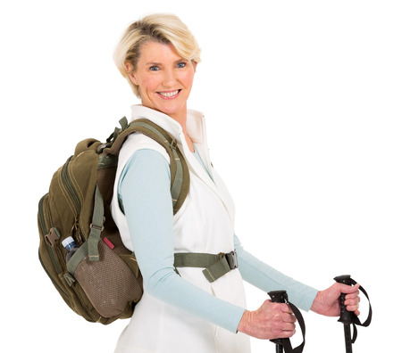 white back: cheerful senior woman with backpack and hiking poles