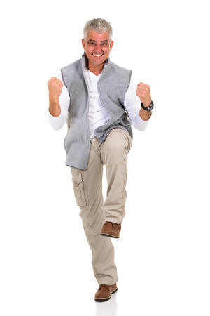 excited man: excited middle aged man holding fists on white background