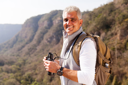 mature man: smiling mature man on top of the mountain
