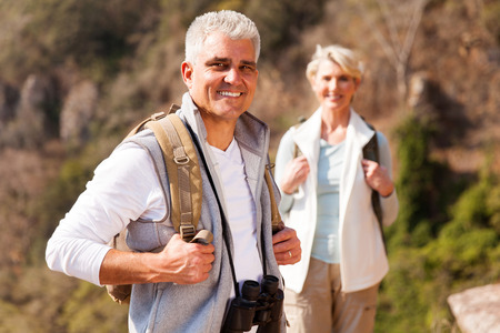 personas mirando: handsome senior male hiker standing in front wife