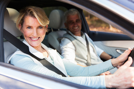 happy senior couple travelling in a car Stock Photo