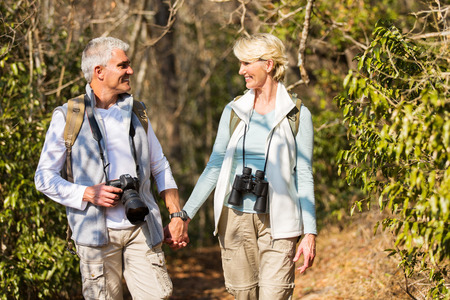middle age: happy mature couple hiking in mountain