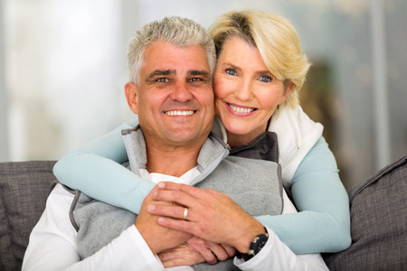 mature men: happy loving middle aged couple relaxing at home