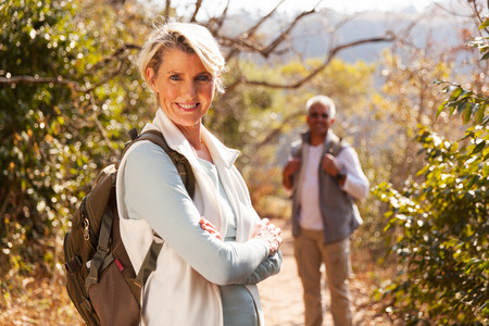 hiker: beautiful middle aged female hiker arms folded outdoors