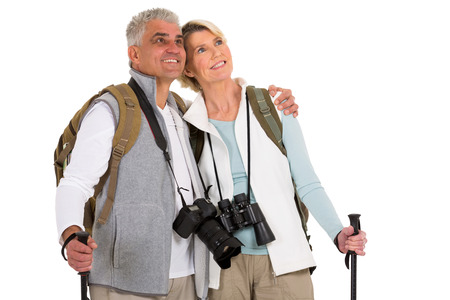 mid age: cute mid age hiking couple looking up on white background Stock Photo