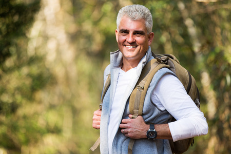 lifestyle caucasian: happy senior man on hike looking at the camera Stock Photo
