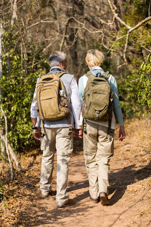 mid age: loving mid age couple hiking in forest